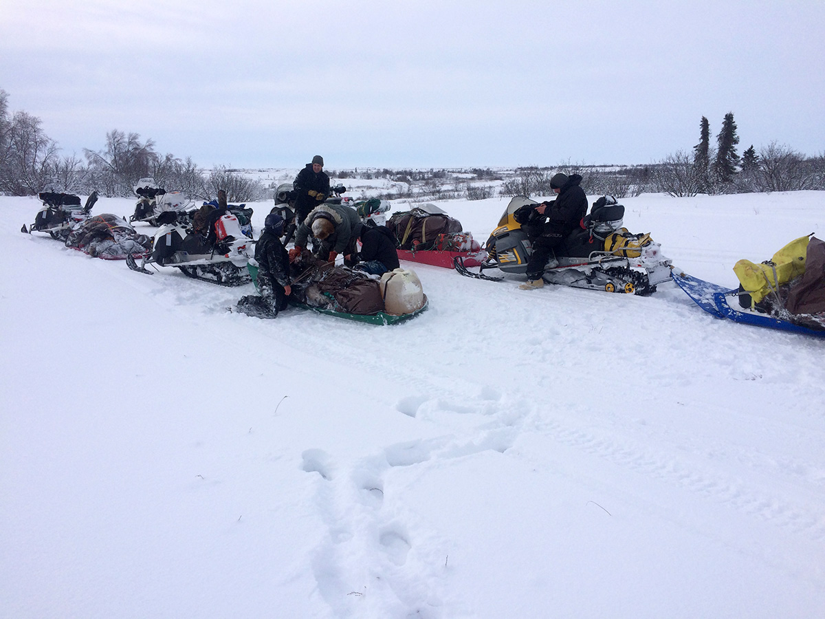 Moose Meet - hunters on snowmobiles